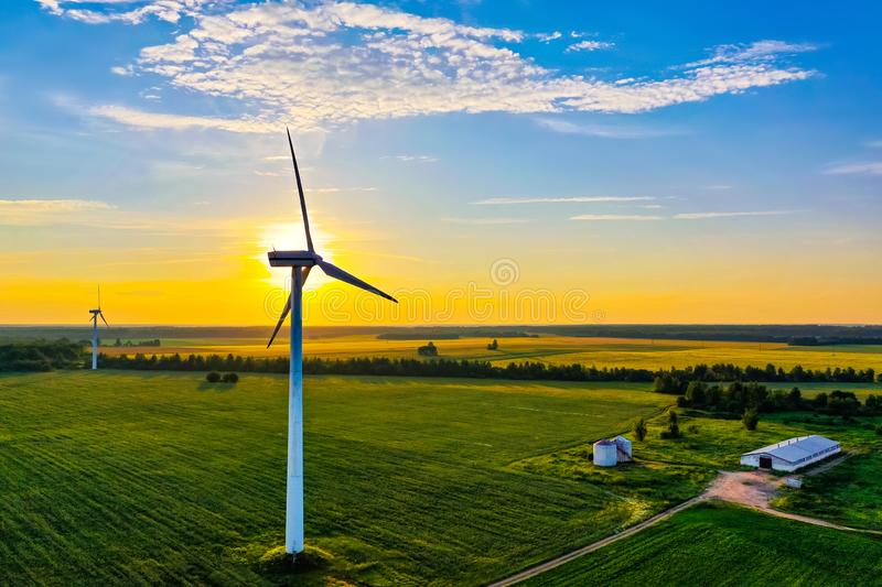 Sunny morning in green countryside, aerial landscape. Farmlands in summer. Energy generation. Sunny morning in the green countryside, aerial landscape. Farmlands royalty free stock photo