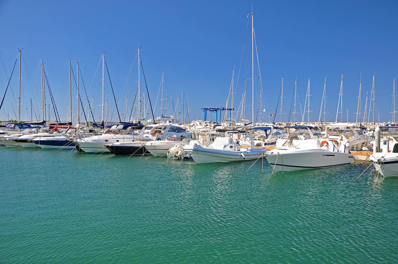 Sunny morning in the marina of Salerno with white yachts royalty free stock photography