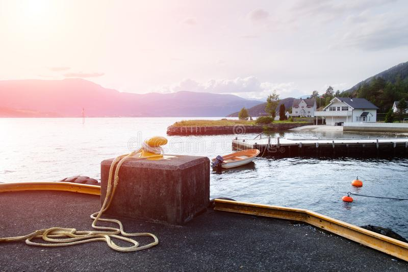 Sunny morning near the ferry moorage. In norwegian village. North sea view, Norway, Europe stock photo