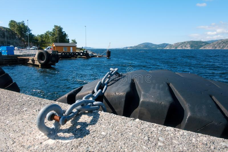 Sunny morning near the ferry moorage. In norwegian village. North sea view, Norway, Europe stock photos