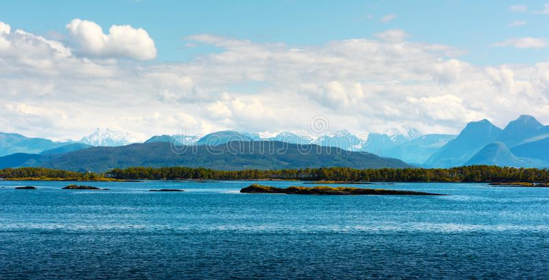 Sunny morning near the ferry moorage. In norwegian village. North sea view, Norway, Europe stock photography