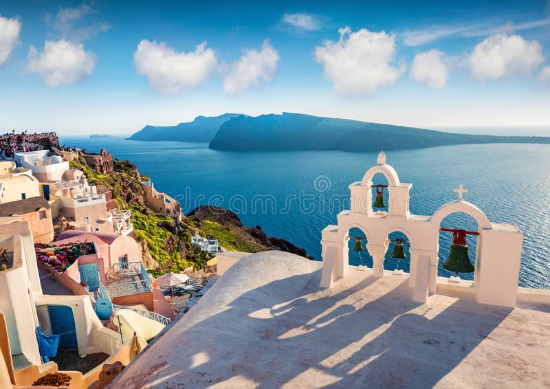 Sunny morning view of Santorini island. Picturesque spring sc ene of the famous Greek resort Oia, Greece, Europe. Traveling concept background. Artistic style stock images