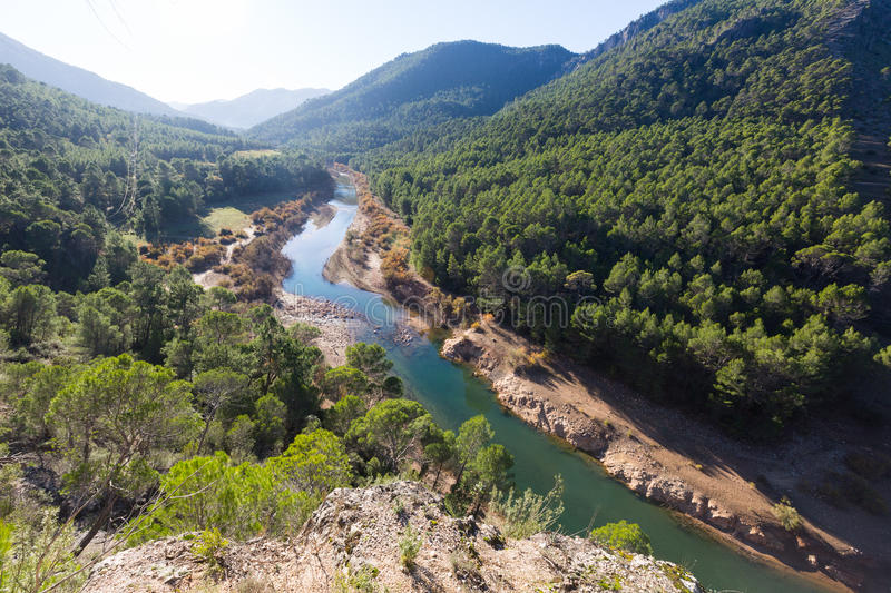 Sunny mountains landscape with river. Guadalquivir river, Andalusia, Spain stock photography