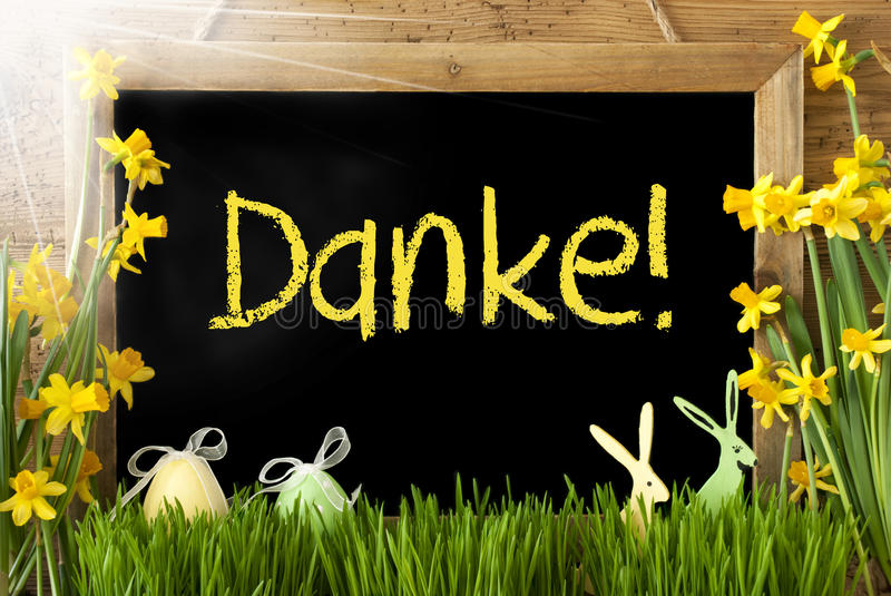 Sunny Narcissus, Easter Egg, Bunny, Yellow Danke Means Thank You. Blackboard With Yellow German Text Danke Means Thank You. Sunny Spring Flowers Nacissus Or royalty free stock photos