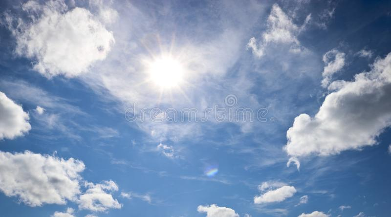 Sunny natural background, blue sky with cirrus and cumulus clouds. The concept of travel, dreams, summer mood. Sunny natural background, blue sky with cirrus and royalty free stock photo