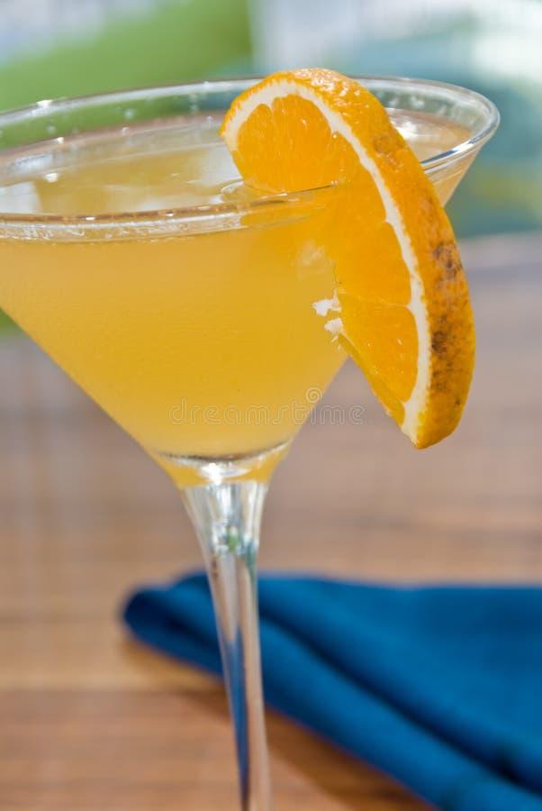 Sunny orange martini. With an orange slice stock images