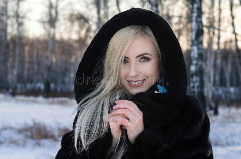 Sunny outdoor winter portrait of young attractive woman stock photo