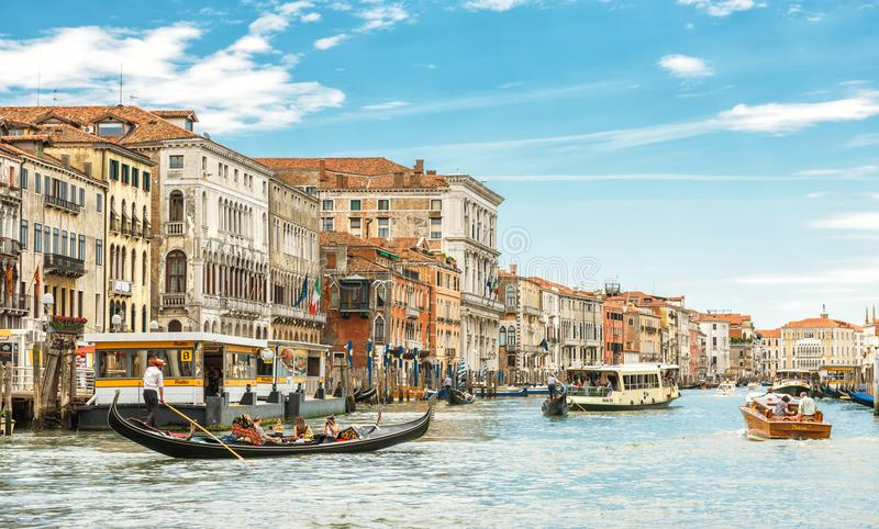Sunny panorama of Grand Canal with tourist boats in Venice royalty free stock photo