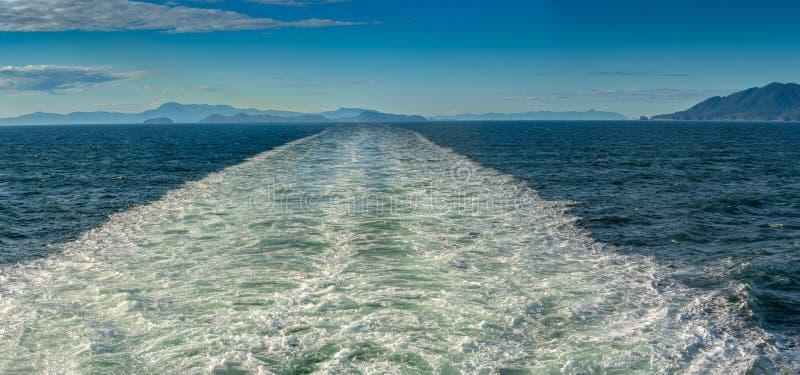 Sunny panorama of turbulent ship`s wake through Stephen`s Passage, Alaska, USA. Sunny bright panorama of turbulent cruise ship`s wake andSoutwest view of vast stock image
