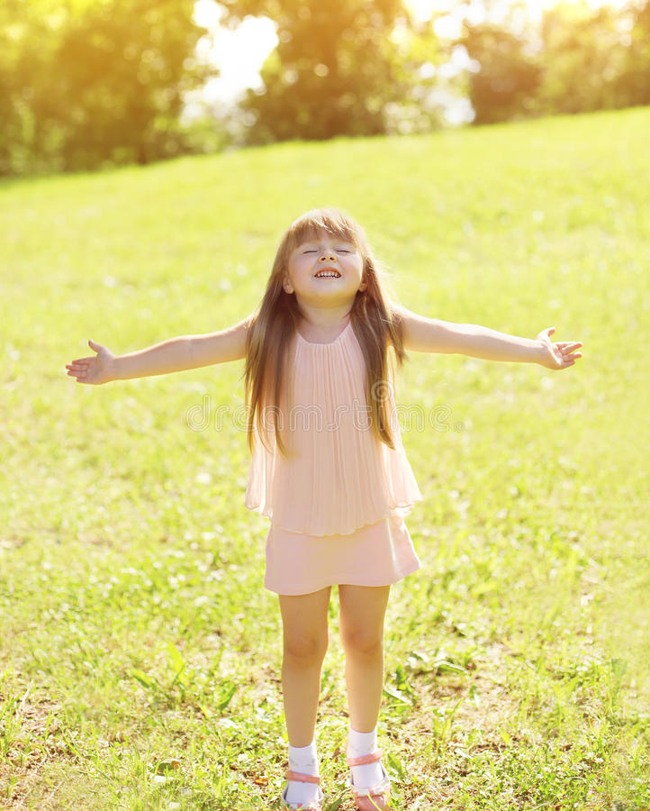 Sunny photo happy little girl child enjoying summer day. And having fun outdoors royalty free stock photo