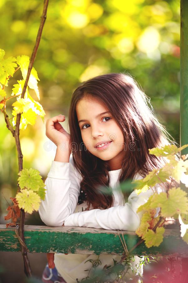 Lovely young girl in the garden stock photo