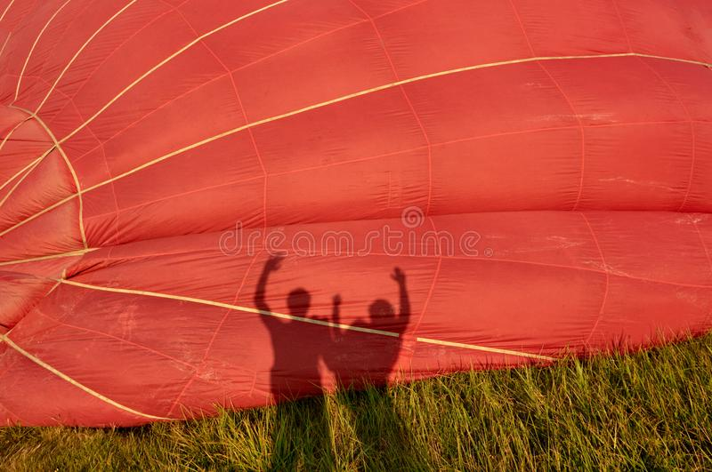 Family silhouette on balloon royalty free stock image