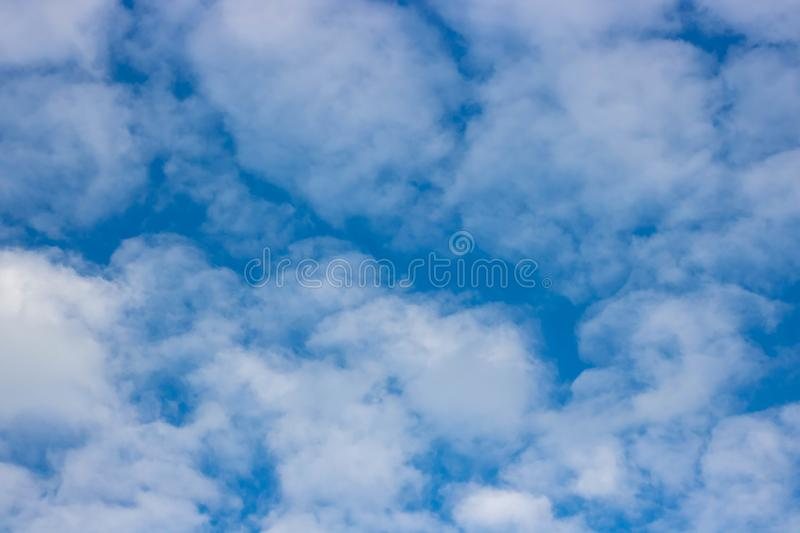 Sunny sky abstract background, beautiful cloudscape, on the heaven, view over white fluffy clouds, freedom concept royalty free stock image