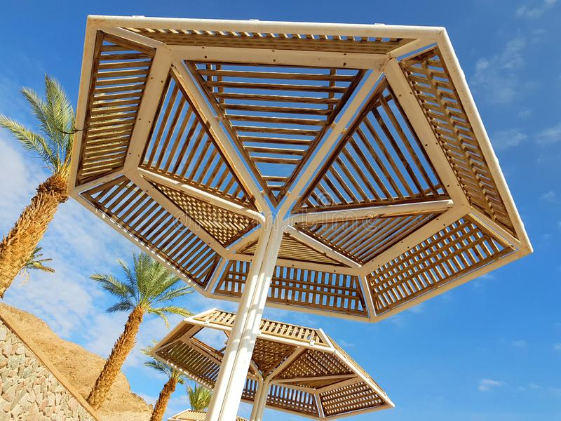 Clear sunny sky and beach umbrellas in Eilat resort; Israel. Sunny sky and beach umbrellas in Eilat resort; Israel stock photo