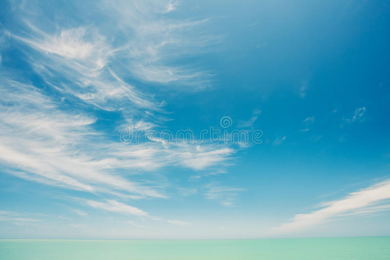 Sunny Sky And Calm Sea Or Ocean. Natural Background With Gently. Sunny Sky Over Calm Water Of Sea Or Ocean. Natural Landscape Background With Gently Blue Colors stock image