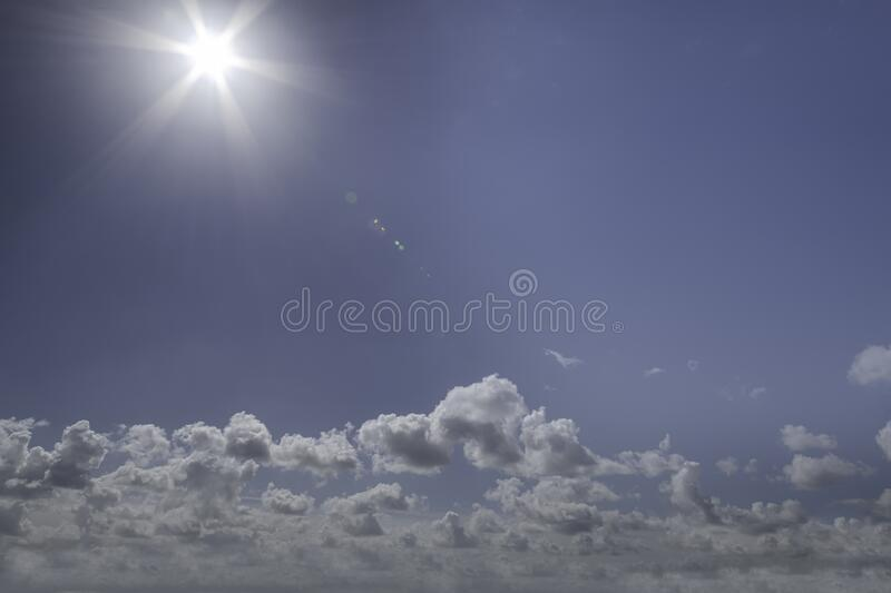 Sunny sky with low clouds stock photography