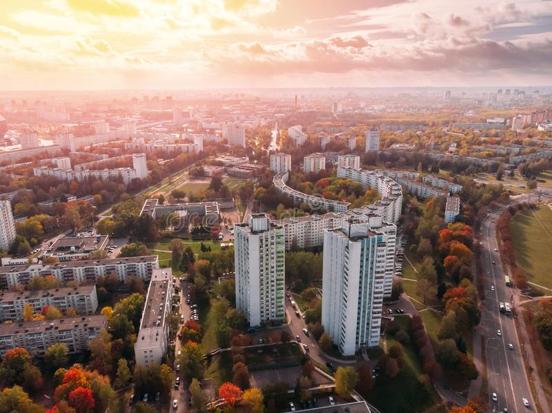 Aesthetics multi-storey apartments mixed with autumn yellowing trees. Minsk, Republic of Belarus. view aerial drone. Sunny sky shining clouds over city landscape stock image