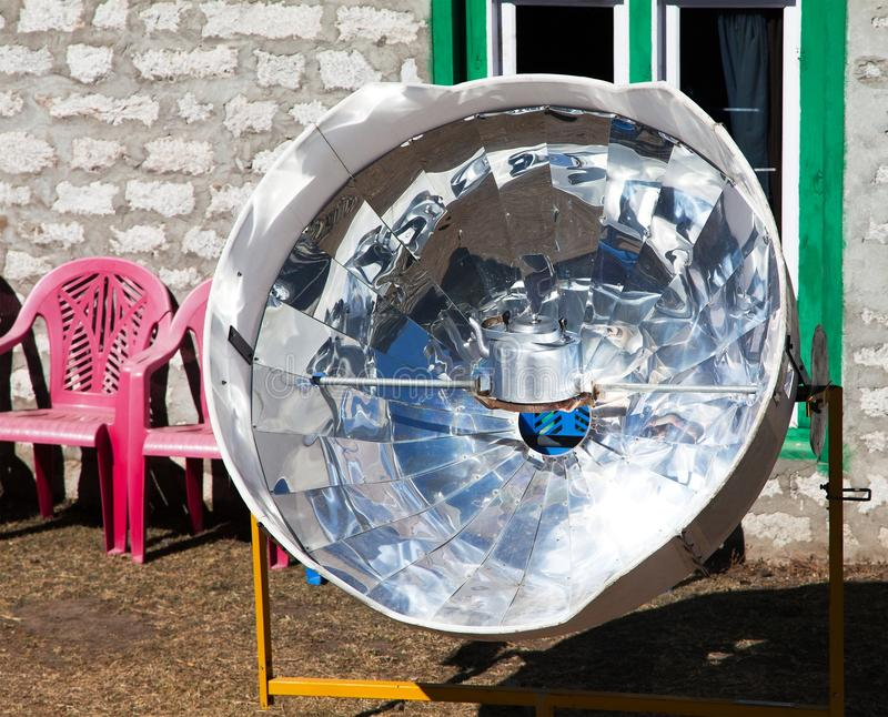 Sunny solar cooker, Everest area, Nepal. View of sunny solar cooker, Everest area, Nepal, ecology cooking stock photo