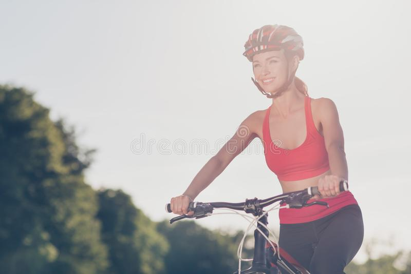 Sunny and sporty mood. Cropped close up of slim sporty girl, rid royalty free stock photography