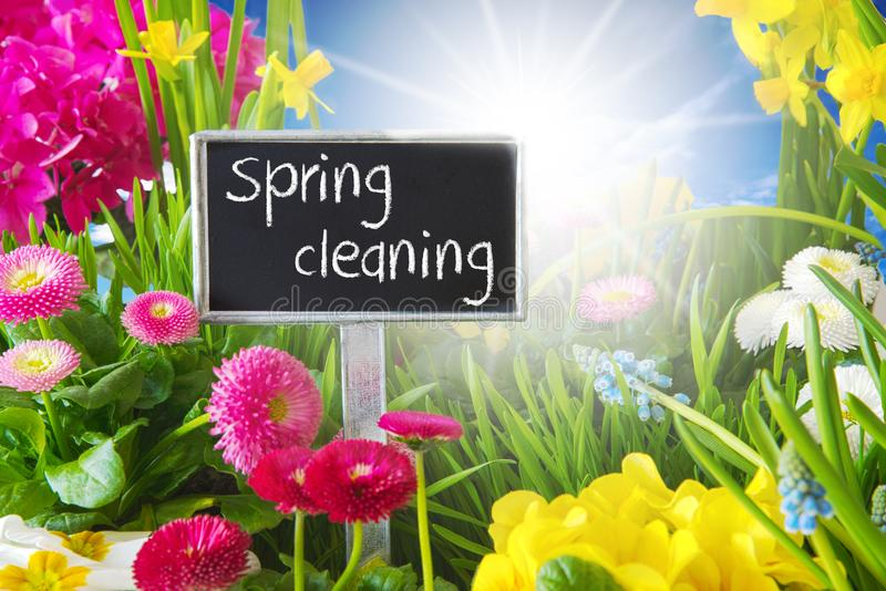 Sunny Spring Flower Meadow, Spring Cleaning. Sign With English Text Spring Cleaning. Sunny Spring Flower Meadow With Daisy, Narcissus, Primrose And Hyacinth stock image