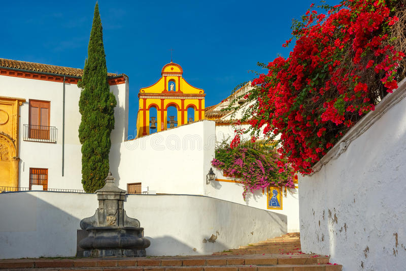 The sunny street in Cordoba, Spain. The street of Cordoba in th sunny day, Cordoba, Andalusia, Spain stock photo