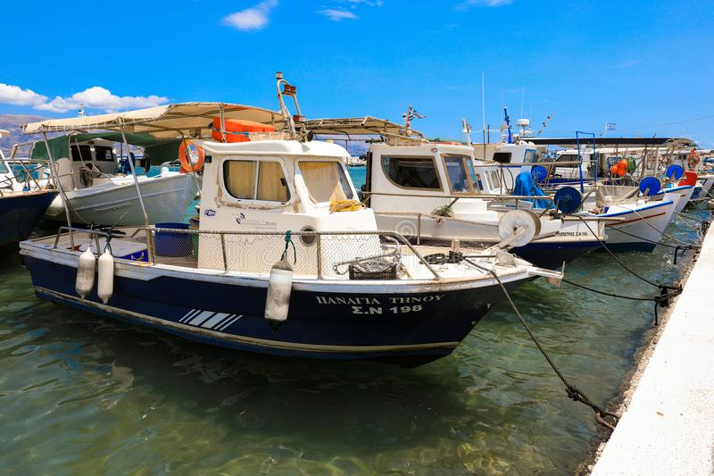 Sunny summer day and beautiful fishing boats in the port of Elafonisos village island, Laconia, Peloponnese, Greece June 2018. Horizontal stock photos
