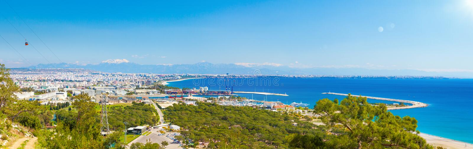 Aerial panoramic view of resort city Antalya, Turkey. Sunny summer day with blue sky and clear sea in Antalya. Aerial panoramic view of beautiful blue sea and royalty free stock images