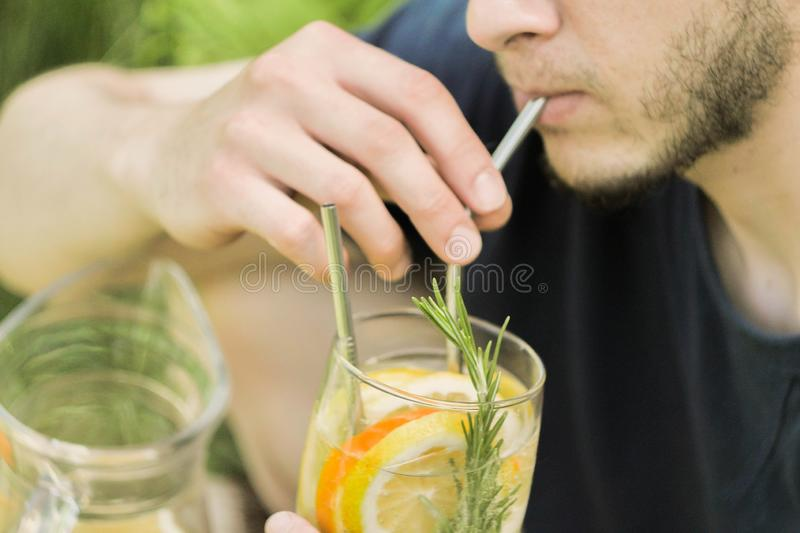 Close up man hold ice cocktail in hand royalty free stock image