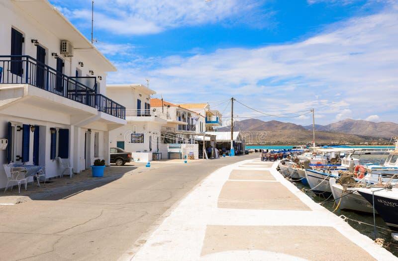 Sunny summer day seafront street of Elafonisos village island, Laconia, Peloponnese, Greece June 2018. Horizontal royalty free stock photography