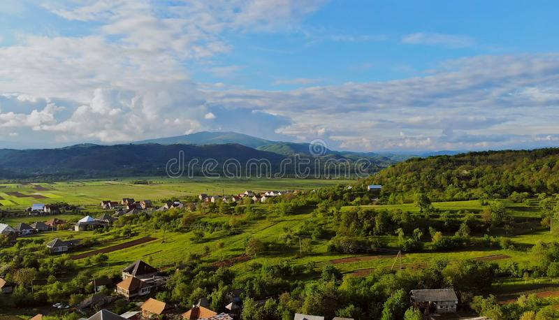 Small village in montain in a sunny summer day and blue sky stock image