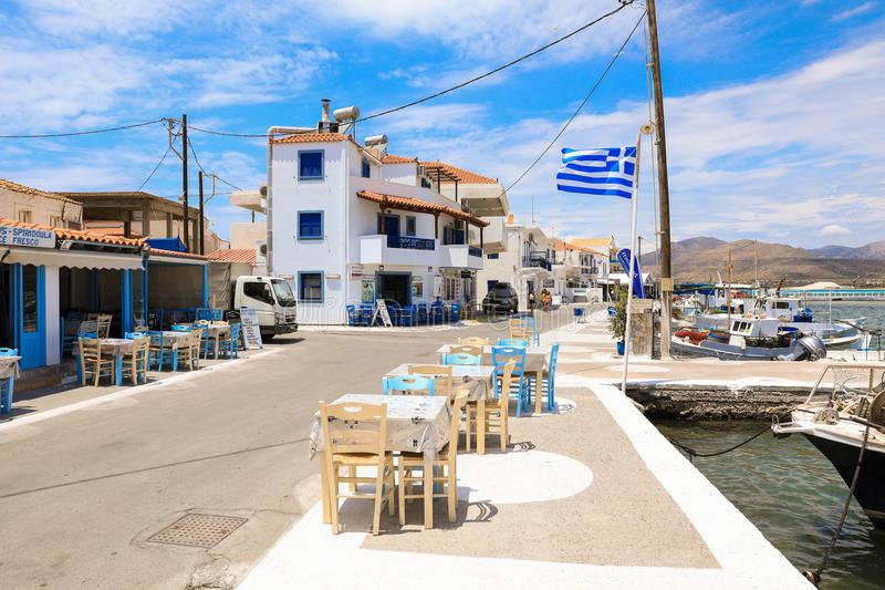 Sunny summer day street near to the port of Elafonisos village island, Laconia, Peloponnese, Greece June 2018. Horizontal stock images