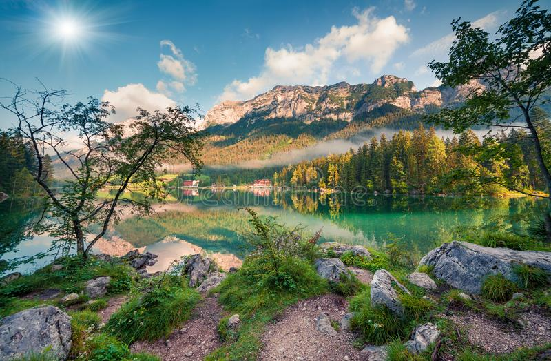 Sunny summer morning on Hintersee lake. Colorful outdoor scene in Austrian Alps, Salzburg, Austria, Europe. Artistic style post processed photo stock photo