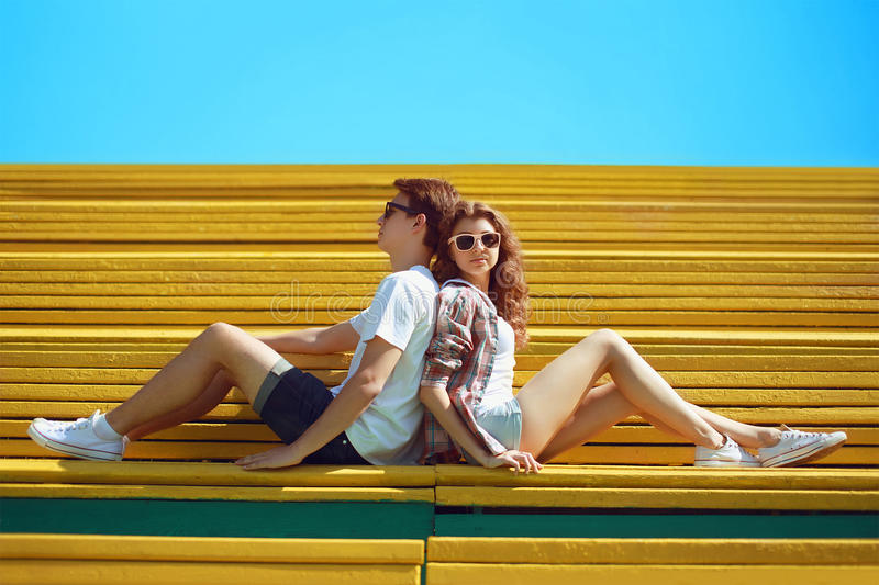 Sunny summer portrait stylish young cool couple teens rest royalty free stock photos