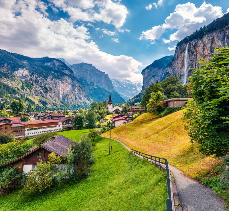 Sunny summer view of great waterfall in Lauterbrunnen village. Splendid outdoor scene in Swiss Alps, Bernese Oberland in the canto. N of Bern, Switzerland royalty free stock photography