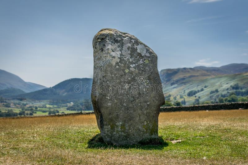 Ancient stone circle at castlerigg, with a mountain. A sunny summers day with a view of the stone circles from a bygone age. white fluffy clouds in the sky. a royalty free stock photo
