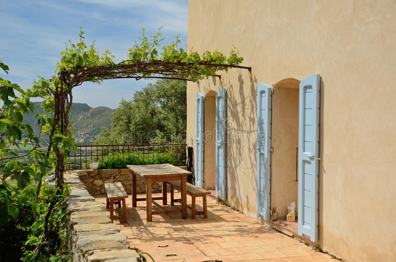 Sunny terrace in the Corsican hilltop village Pigna royalty free stock image