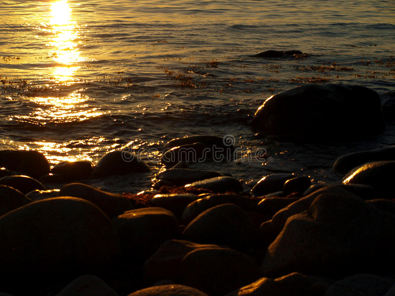 Sunny twilight. A beautiful sunset over the coast of the Baltic Sea, to near Hassle on the Danish island of Bornholm royalty free stock photography