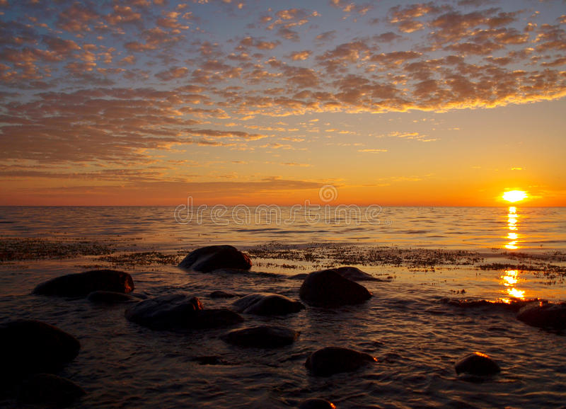 Sunny twilight. A beautiful sunset over the coast of the Baltic Sea, to near Hassle on the Danish island of Bornholm royalty free stock photos