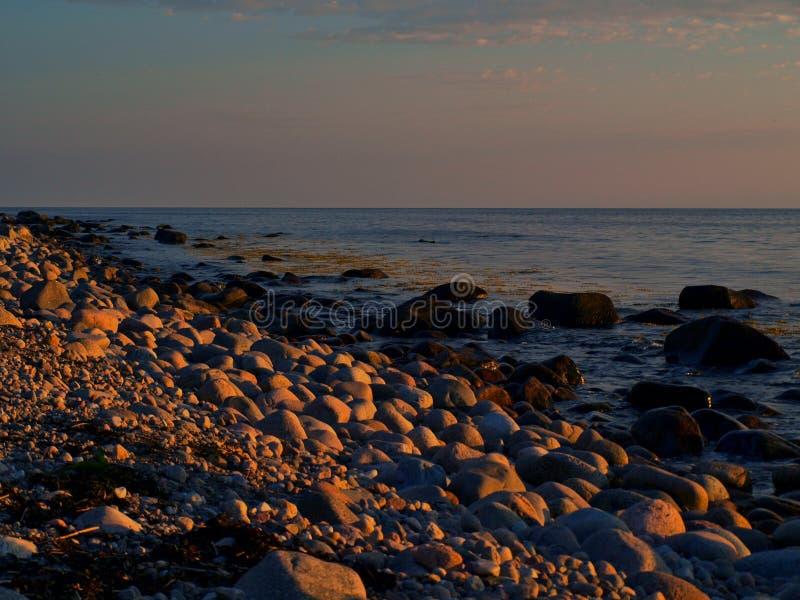 Sunny twilight. A beautiful sunset over the coast of the Baltic Sea, to near Hassle on the Danish island of Bornholm royalty free stock photo