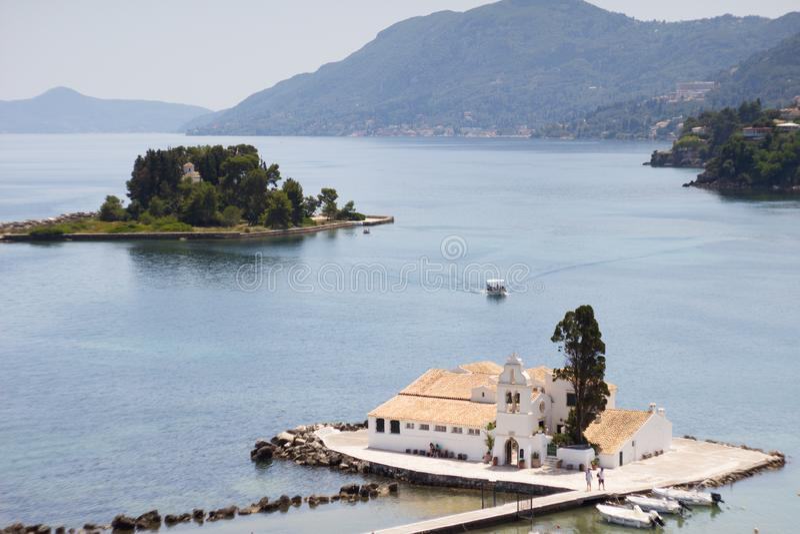 Sunny view of Vlacherna Monastery and Mouse island Pontikonisi on Corfu, Kerkyra, Greece. Postcard view stock photo