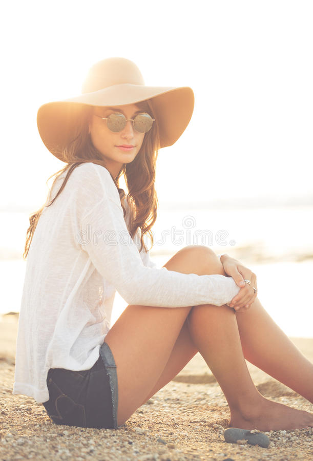 Sunny warm portrait of a beautiful young girl stock images