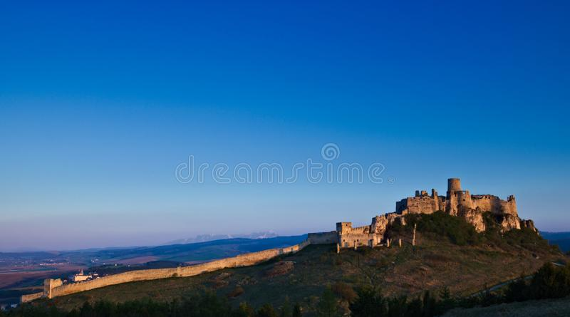 View of the Spis castle from the southeast in the morning in early spring with the Tatra mountains in the background royalty free stock photos