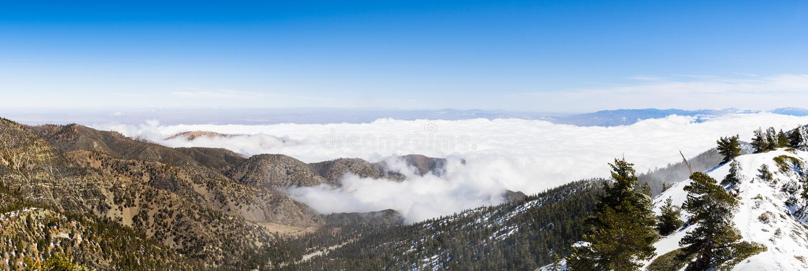Sunny winter day with fallen snow and a sea of white clouds on the trail to Mt San Antonio (Mt Baldy), Los Angeles county,. Southern California stock photography