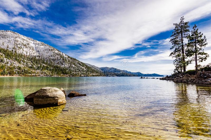 Sunny winter day on the shoreline of Lake Tahoe, Sand Harbor State Park, Sierra mountains, Nevada royalty free stock photo