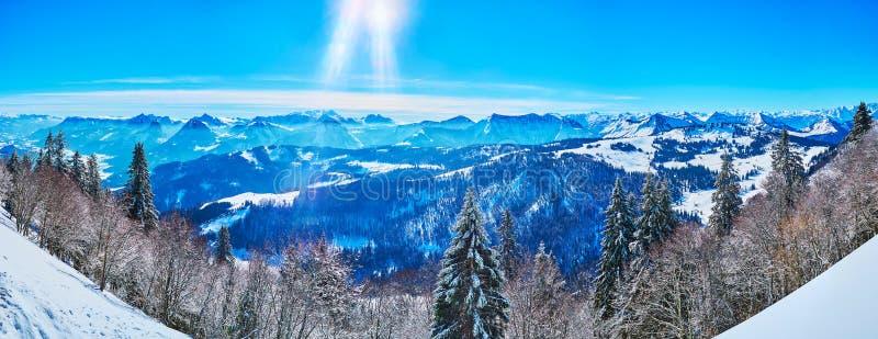 Sunny winter day on Zwolferhorn, St Gilden, Salzkammergut, Austria. Breathtaking panorama of Salzkammergut Alps and forests from Zwolferhorn mountain top on royalty free stock images