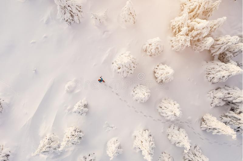 Sunny winter landscape with man on snowshoes, aerial view. stock photos