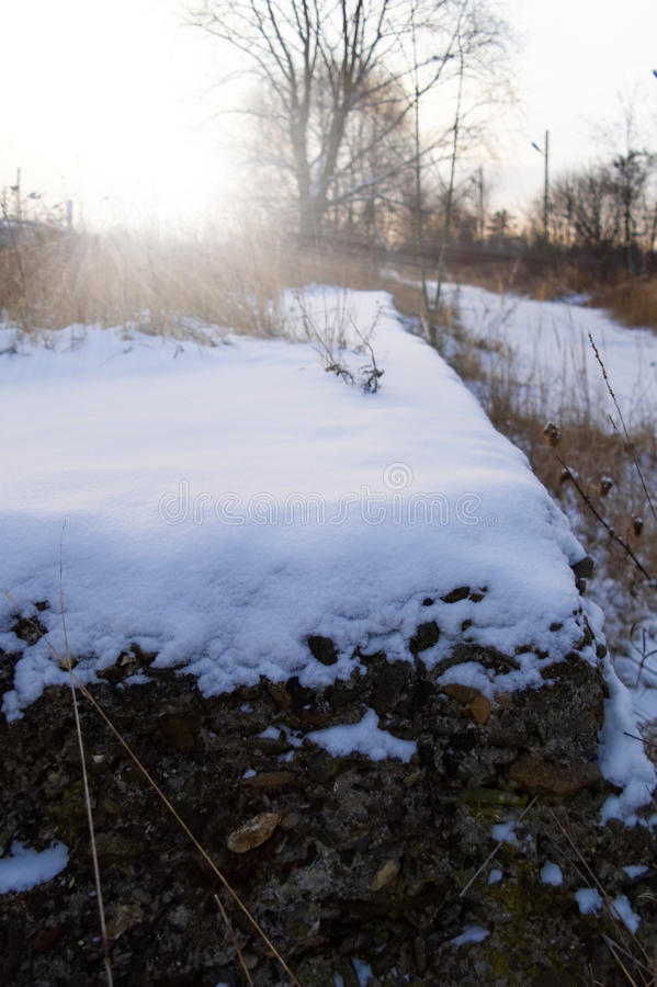 Sunny winter morning. Closeup of the snow covered concrete ruined substructure at sunny winter morning stock photos