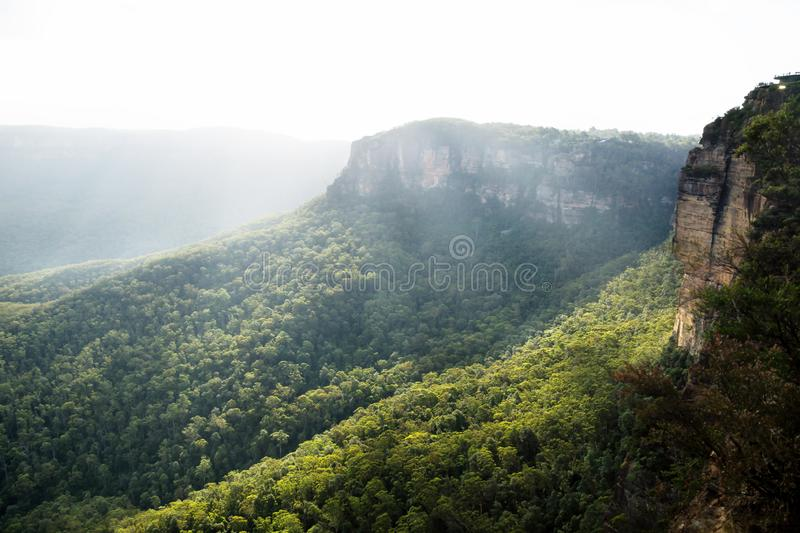Sunrays over the Blue mountains at three sisters rock formation, Katoomba, New South Wales, Australia royalty free stock photos
