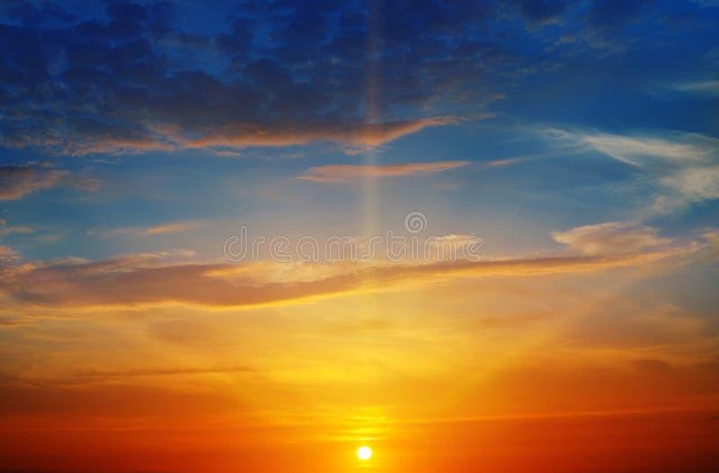 Sunrays and sky. The sun rays illuminate the sky above the horizon stock photography