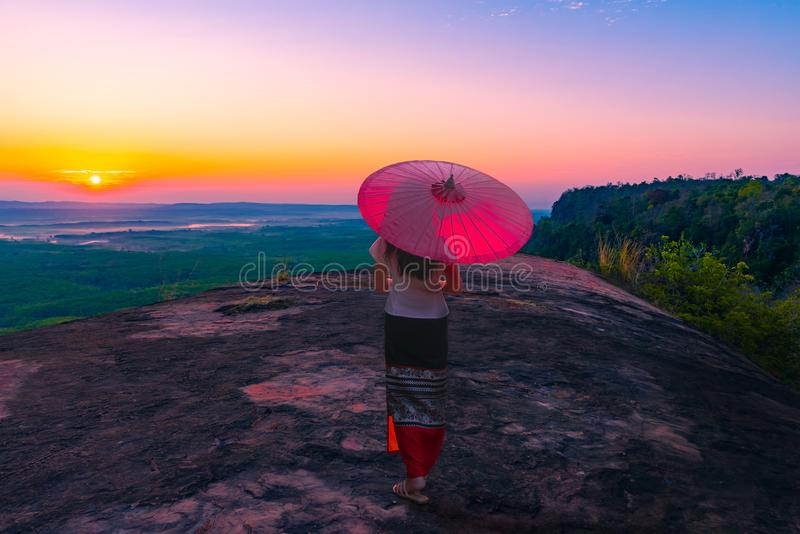 Sunrie with mist at three whale rock in Phu sing mountain Buengkan province,Thailand.  stock photos